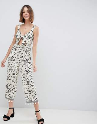 Asos Design DESIGN floral jumpsuit with cut out and tie detail