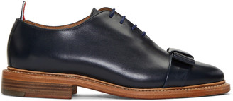 Thom Browne Navy Wholecut Bow Oxfords $1,020 thestylecure.com