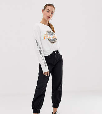 Asos DESIGN Petite slouch denim track pant in washed black with elasticated cuff