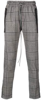 Represent checkered track trousers
