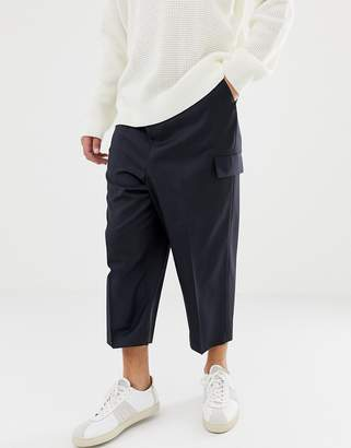Asos DESIGN drop crotch tapered smart pants in navy wool with cargo pockets