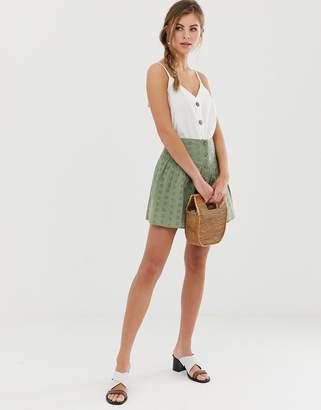Asos Design DESIGN broderie mini skirt with button front