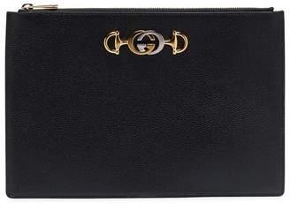 49d0b523505 Gucci black GG brooch-embellished leather clutch bag