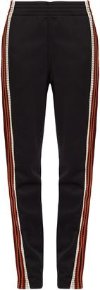 WALES BONNER Palms contrast-stripe track pants $404 thestylecure.com