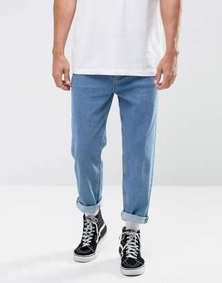 Asos DESIGN skater jeans in mid wash blue
