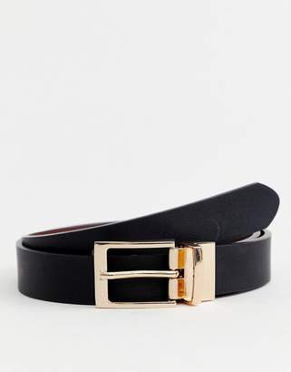 Asos Design DESIGN faux leather slim reversible belt in black and brown with gold buckle