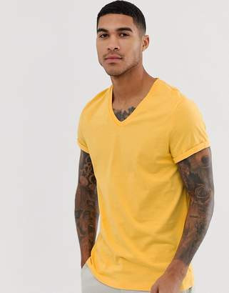c73183ddb Asos Design DESIGN t-shirt with v neck and roll sleeve in yellow