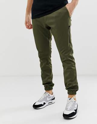 Religion tapered fit joggers in khaki with cuff hem