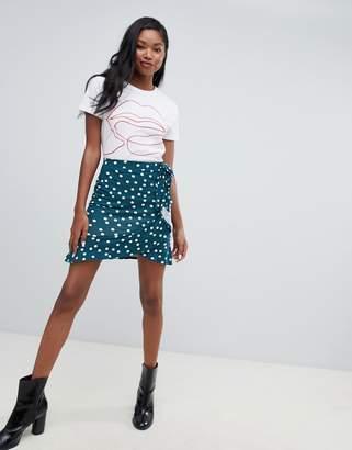 Asos DESIGN mini wrap skirt in polka dot print