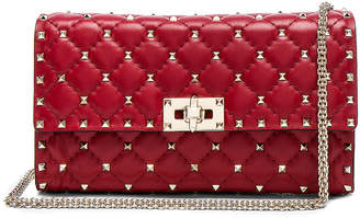 Valentino Rockstud Spike Clutch in Red | FWRD