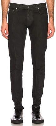 REPRESENT Essential Waxed Denim Jeans.