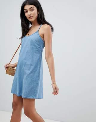 Asos DESIGN denim slip dress with low back in midwash blue