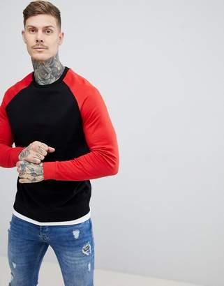 Asos DESIGN sweatshirt with hem extender in black and red