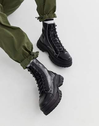 Asos Design DESIGN lace up boots in black faux leather with contrast stitch detail