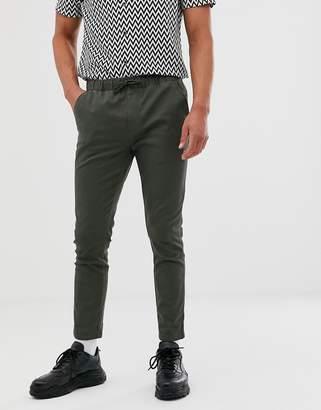 Asos Design DESIGN skinny chinos with elastic waist in dark khaki
