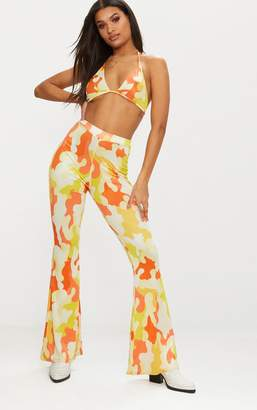 PrettyLittleThing Orange Camo Print Slinky Flared Trousers