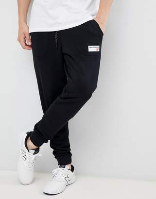 4a0b8faede New Balance small logo joggers in black MP83515_BK