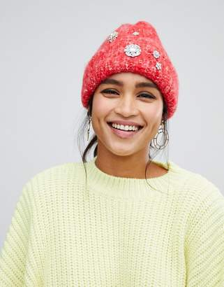 Asos DESIGN fluffy embellished beanie in two tone knit
