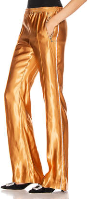 Area Liquid Satin Crystal Stripe Track Pant in Toffee | FWRD