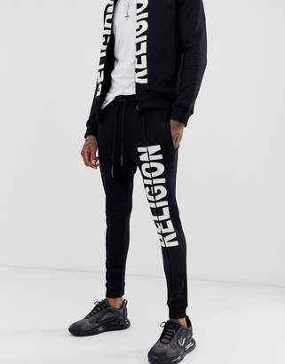 Religion joggers with logo print in black