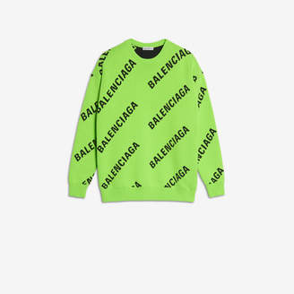 Balenciaga Allover Logo Crewneck in neon green and black jacquard cotton knit