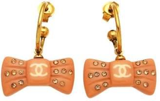 Chanel CC Logo Gold Tone Metal Ribbon Rhinestone Dangle Stud Earrings