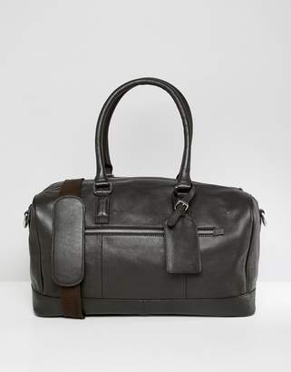 9b035c5be46a9a Asos Design DESIGN leather holdall in brown with luggage tag