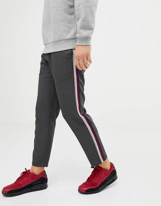 Pull&Bear pants in gray with multi colored side stripe