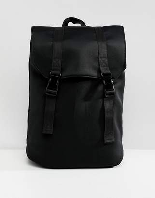 Asos DESIGN mini backpack in black scuba with internal laptop pouch