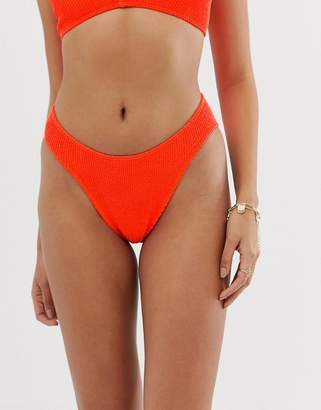 Asos Design DESIGN mix and match crinkle high leg hipster bikini bottom in neon orange