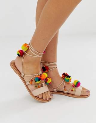 1466e309a6d7 Asos Design DESIGN Fun Fair pom pom leather tie leg flat sandals