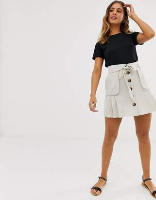 Asos Design DESIGN linen pleat mini skirt with button front and pockets