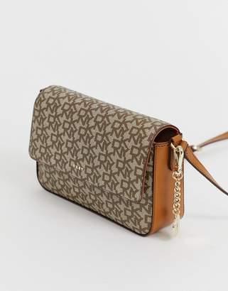 DKNY Bryant flap crossbody bag in multi logo
