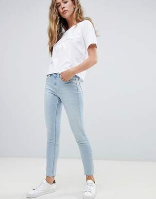 Calvin Klein high rise slashed skinny jeans