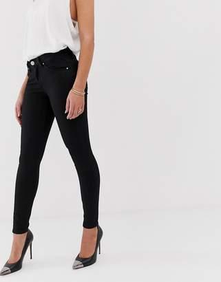 5d594e0084b Asos Design DESIGN Lisbon mid rise skinny jeans in clean black in ankle  grazer length