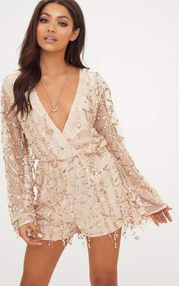 aa7ee49f30 at PrettyLittleThing · PrettyLittleThing Champagne Tassel Sequin Wrap Front  Playsuit