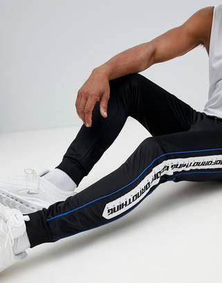 Good For Nothing skinny joggers in black with logo side stripe
