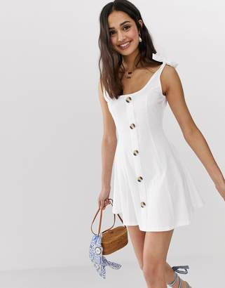 Asos Design DESIGN mini button through slub sundress with tie shoulders