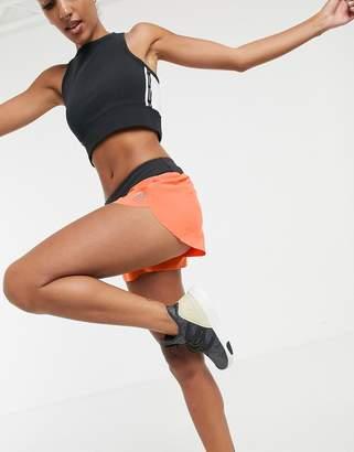 Reebok CrossFit shorts in orange