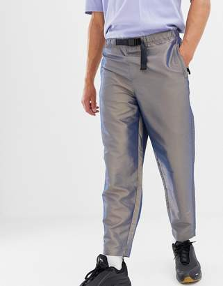 Asos Design DESIGN tapered pants in irridescent nylon with belt detail