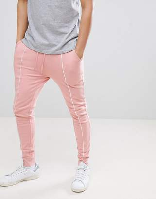 Asos Design DESIGN Super Skinny Joggers In Pink With White Piping