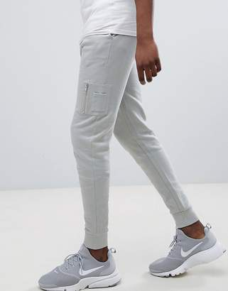 Asos Design DESIGN skinny joggers with Ma1 pocket in light grey