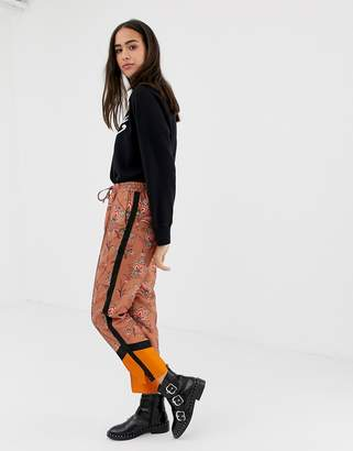 Maison Scotch floral and contrast panel print trousers