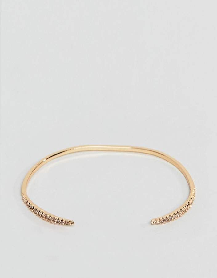 ASOS DESIGN cuff bracelet with fine crystal tapered design in gold