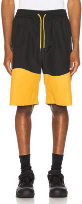 Pyer Moss Wave Panel Track Shorts in Black & Yellow | FWRD