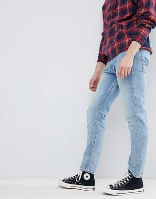 Jack and Jones Tapered Fit Jeans In Washed Denim