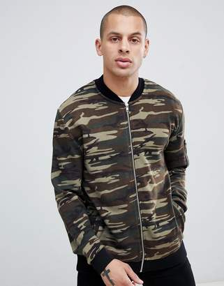Asos DESIGN jersey bomber jacket in camo with MA1 pocket