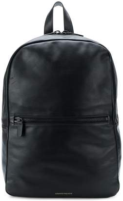 Common Projects minimalist logo backpack