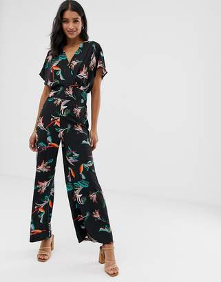 Liquorish wrap front jumpsuit in tropical floral print