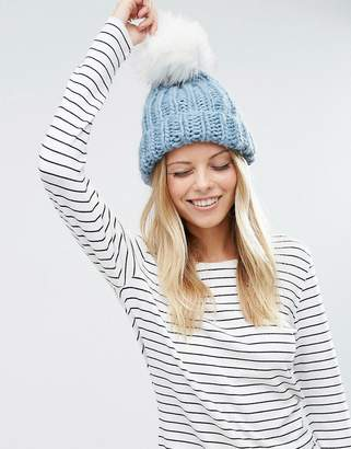 ASOS Chunky Knit Beanie with Faux Fur Pom $18.50 thestylecure.com